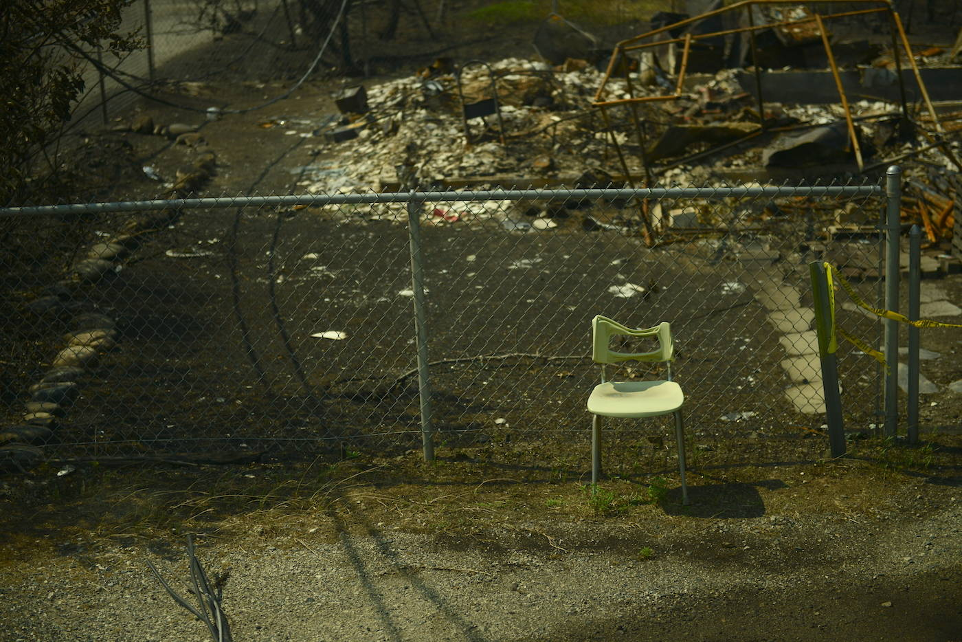 A chair sits on Main Street in Lytton, B.C. on Friday, July 9, 2021, nine days after a wildfire ripped through the village on June 30, 2021. (Jenna Hauck/ Black Press Media)